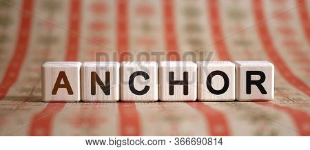 Anchor - Text Concept On Wooden Cubes On A Striped Bright Background