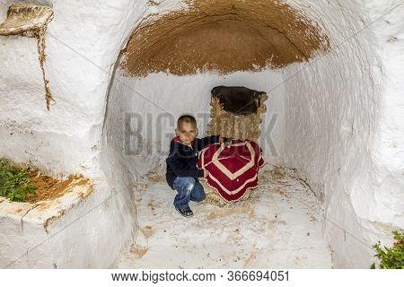 Matmata.tunisia.may 21, 2013.boy In The Underground Home Of Troglodytes Indigenous Peoples Inhabitin