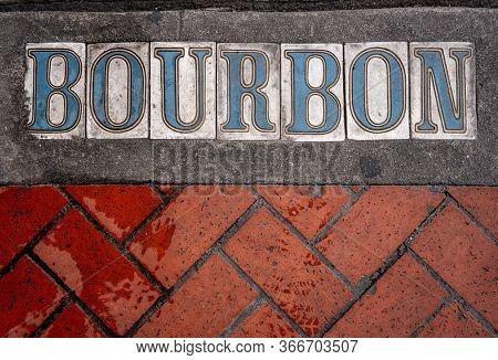 Bourbon Street Tiles And Bricks On Wet Sidewalk