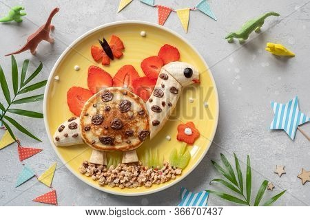 Cute Dinosaur Shaped Pancake With Fruits For Kids Breakfast