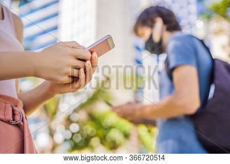 Contact Tracing App Covid-19 Pandemic Coronavirus Mobile Application - People Wearing Face Mask Usin