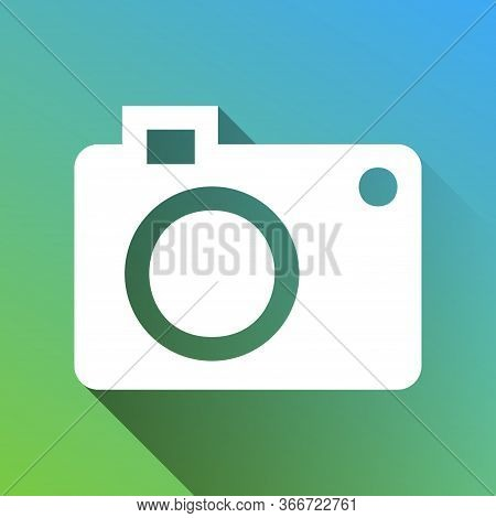 Digital Camera Sign. White Icon With Gray Dropped Limitless Shadow On Green To Blue Background. Illu