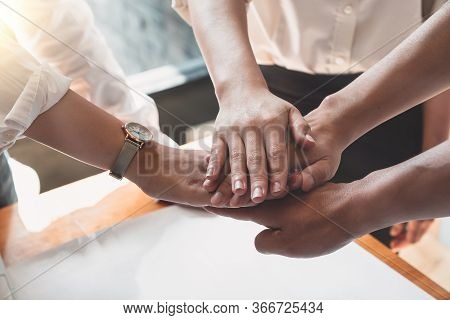 Teamwork Success. Business People Group Team Happy Showing Teamwork And Joining Hands