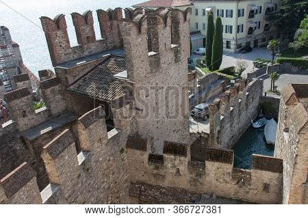 Italy, Lombardy - August 05 2018: The Above View Of The Scaliger Castle At The Entracne To Old Town