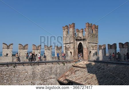Italy, Lombardy - August 05 2018: The View Of The Tourist On The Top Of The Tower, Scaliger Castle O