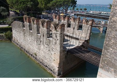 Italy, Lombardy - August 05 2018: The View Of The Bridge Across Water Moat At The Scaliger Castle En