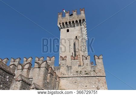 Italy, Lombardy - August 05 2018: The View Of The Scaliger Castle Tower On August 05 2018 In Sirmion