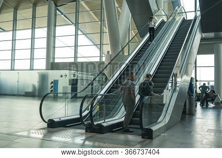 Airport Platov, Russia - 24.05.19: Two Adult Men Are Climbing An Escalator At The Airport. Beautiful