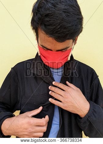 Capture Of A Young Indian Man Wearing A Face Mask To Protect Against The Coronavirus During Lockdown