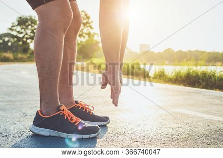 Man Workout Wellness Concept : Close Up Runner Feet With Sneaker Shoe Running On Road In The Park. F