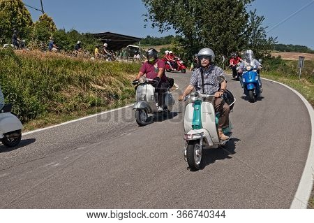 Group Of Bikers Riding Vintage Italian Scooters Lambretta And Vespa On The Hills During The Scooter