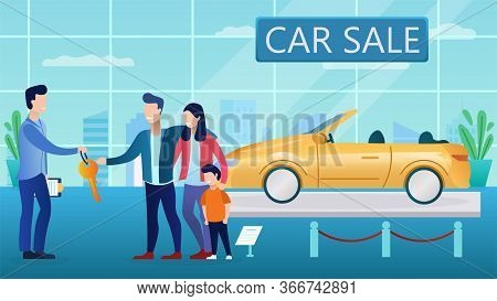 Young Couple Buy A Car In The Salon. Interior Of The Showroom. The Seller Hands Over The Car Keys. C
