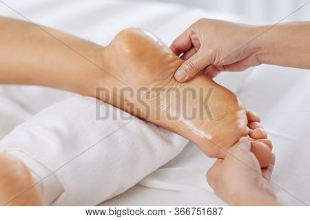 Close-up Image Of Woman Getting Relaxing Feet Massage With Oils In Spa Salon