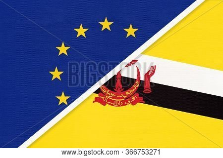 European Union Or Eu And Brunei National Flag From Textile. Symbol Of The Council Of Europe Associat