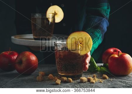 Female With Tray Hold Glass Of Cider. Composition With Cider And Apple On Gray Table