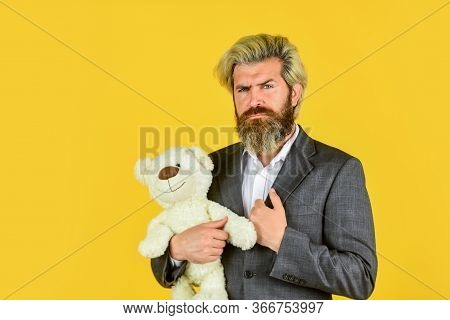 Man In Jacket Hold Teddy Bear. Bizarre People Concept. Businessman Play With Toy. Soothing Toy With