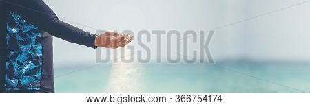 Freedom Hand , Release And Let It Go Concept. Hand Let Go Of Man Release Sand On Beautiful Sea Beach