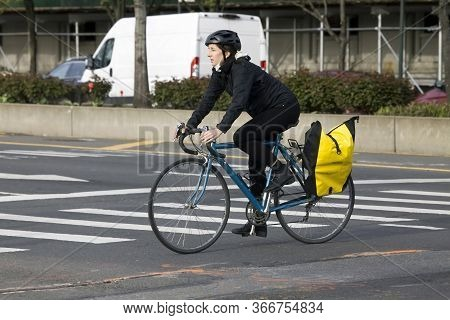 Bronx, New York/usa - April 20, 2020: Caucasian Woman Rides Bike While Using Maks But Not Covering H