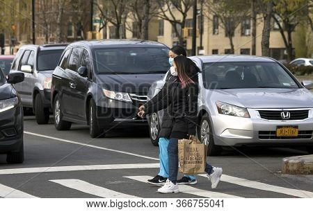 Bronx, New York/usa - April 20, 2020: Women Wearing Mask While Crossing Street During Covid-19 Pande
