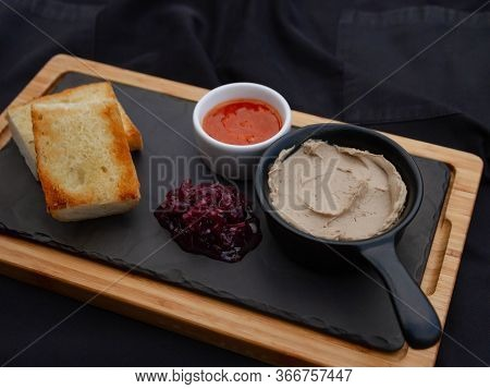Pate Served On A Restaurant Table With A Side Dish And Appetizing Toasted Bread, Close-up. Tomato Sa
