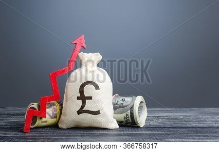 Pound Sterling Money Bag And Red Arrow Up. Influx Of Investment And Capital, Increase Of Wealth. Eco