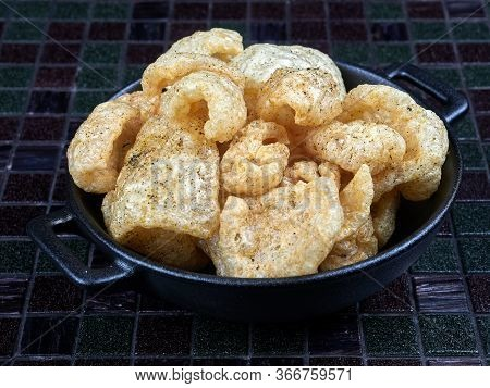 Pork Rinds Also Known As Chicharron Or Chicharrons, Deep Fried Pork Skin. Savory Snack.