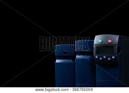 Frequency Inverter. Three Inverter Controller Set Isolated On Black Background. Power Inverter With