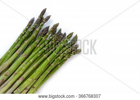 Bunch Of Organic Green Asparagus (asparagus Officinalis) In The Corner Isolated With Small Shadows O