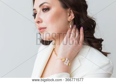Elegant Woman With Earrings, Close Up Portrait. Accessories, Jewelry And Bijouterie Concept.