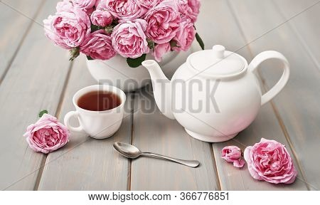 Tea With Pink Roses On Grey Wooden Table, Copy Spase. Greeting Card For Mother's Day. Valentine Card