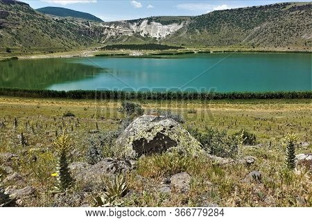 Amazing Mountain Lake In The Crater Of An Extinct Volcano. Lake Nar Is Perfectly Round With Emerald