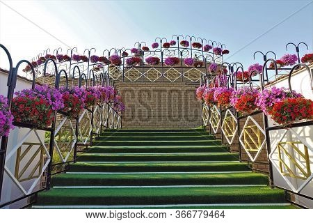 Beautifully Decorated Staircase In The Park. The Steps Are Covered With Artificial Grass. On Openwor