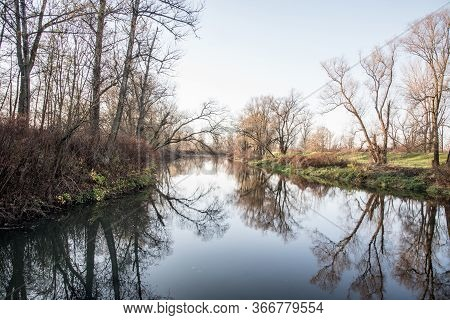 Autumn Scenery Of Olse River Near Karvina City In Czech Republic With River And Trees Around Reflect