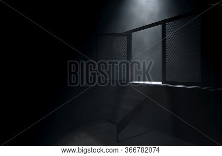 A Spotlighting Highlighting The Door Of A Mma Fight Cage Arena Dressed In Black Padding On A Dark Ba