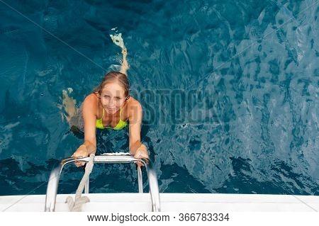 Joyful Young Woman Portrait. Happy Girl In Bikini Climb Aboard Of Sailing Yacht After Swimming. Have