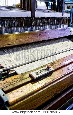 Close Up Of A Cotton Thread Weft Loom Machine In A Conveyor Belt Factory