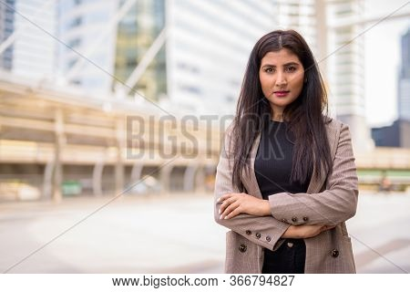 Young Beautiful Indian Businesswoman With Arms Crossed At The Skywalk Bridge