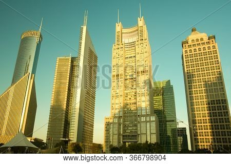 Skyline Of Office Buildings At Lujiazui Financial District From Central Greenfield At Sunrise, Pudon