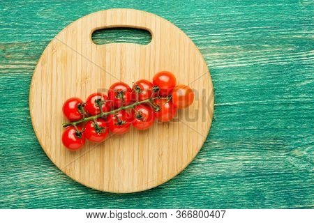 Tomatoes On The Vine On Rustic Wooden Background With Copy Space. Flat Lay Or Top View.