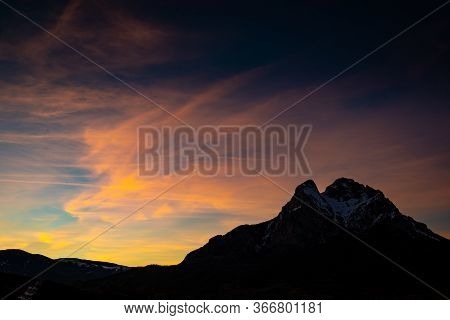 Peak Of Pedraforca In Catalonia Snowed With Clear Sky During Sunset
