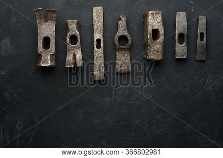Old Rusty Hammers On Dark Background With Place For Text. Minimal Black.