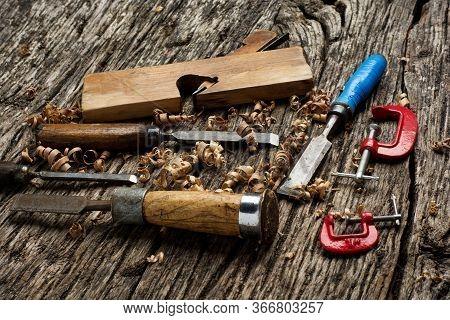 Carpenter Tools On Dark Wooden Pine Wood Table.