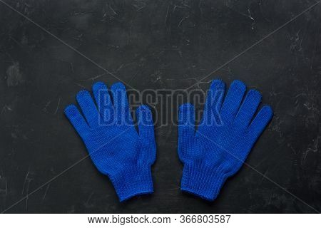 Blue Working Gloves Over Dark Background, Construction Tools. Minimal Black