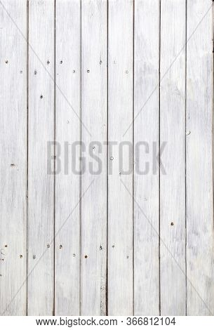 Texture of olden wood planks with paint of white color. Horizontal or vertical background with white painted boards