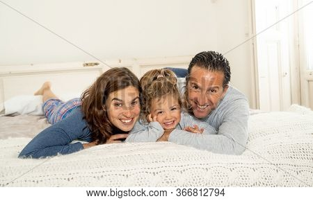 Covid-19 Lockdown. Beautiful Happy Family Relaxing And Playing Together In Bed Staying At Home Durin