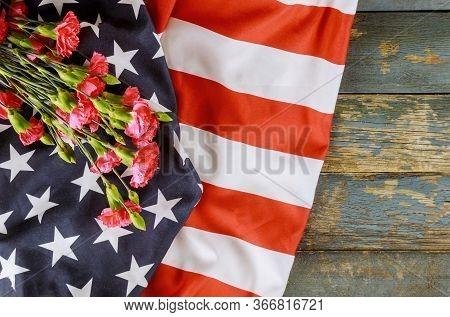 American Flag On Memorial Day Honor Respect Patriotic Military Us In Pink Carnation Old Wooden Backg