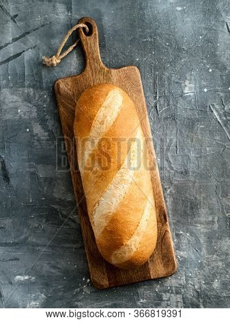 British White Bloomer Or European Baton Loaf Bread On Gray Background. Top View Or Flat Lay. Copy Sp