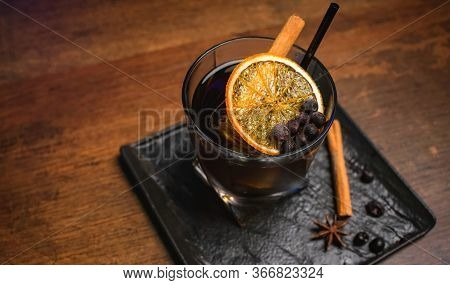 Whiskey With Cinnamon Stick And Dried Orange Twist