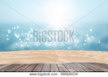 Wooden Table With Tropical Beautiful Seascape View Of Sand Beach And Blurred Blue Sky With Bokeh Sun