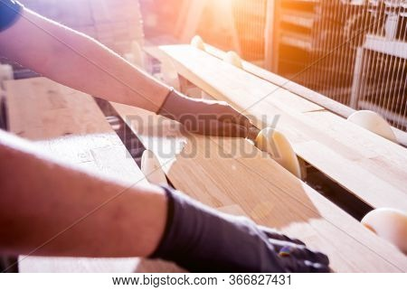 Carpenter With Fibreboards At Furniture Factory Workshop. Woodworking Industry